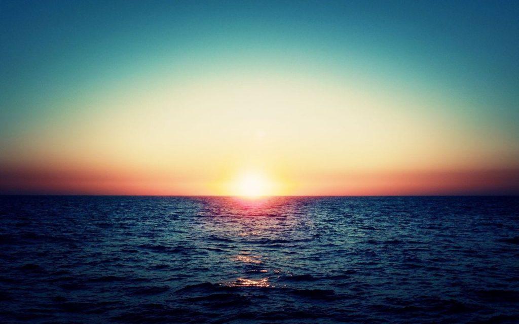 far sunset in te ocean horizon wide